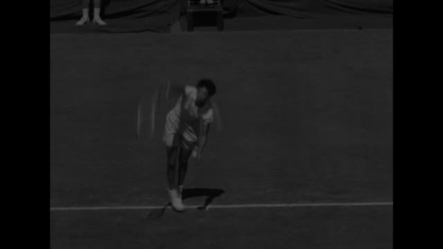 men playing tennis / shirley fry and althea gibson walking toward camera / althea gibson / shirley fry / fry and gibson play / crowd / crowd applauds... - tennis racket stock videos & royalty-free footage