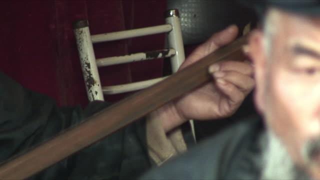 CU ZO ZI PAN MS Men playing traditional instruments, Lijiang, China