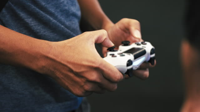 men playing video games - leisure games stock videos & royalty-free footage