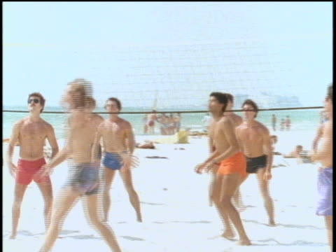men playing volleyball on florida beach - shirtless stock videos & royalty-free footage