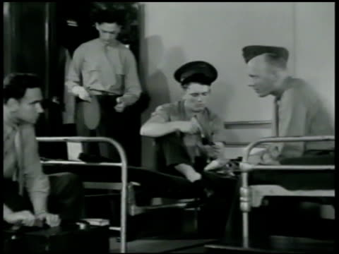 men polishing boots, playing guitar, talking about where they're from . officer entering barracks, 'ten hut,' cadets standing at attention, 'carry... - 1942 stock videos & royalty-free footage