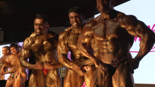 men pose during the fit angel classic bodybuilding competition in bangkok thailand - body building stock videos & royalty-free footage