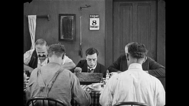 1922 Men pray before spearing food, frustrating a hungry man (Buster Keaton)