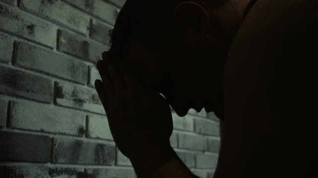 men praying at prison cell - prisoner stock videos & royalty-free footage