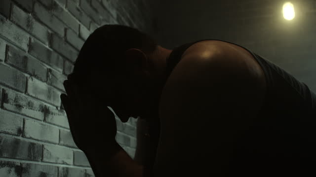 men praying at prison cell - jail cell stock videos & royalty-free footage