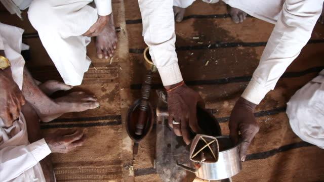 ms men preparing opium tea / rajasthan, india - narcotic stock videos & royalty-free footage