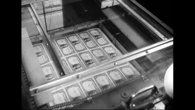 Men printing dollar bills