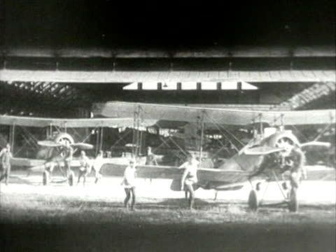 men pulling biplanes from hangar - 1927 stock videos & royalty-free footage