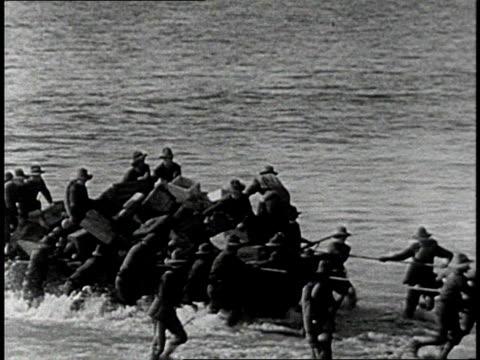 REENACTMENT Men pulling loaded boat to shore / Cuba