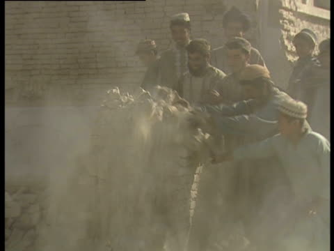 men push a crumbling brick structure over - kandahar afghanistan stock videos & royalty-free footage