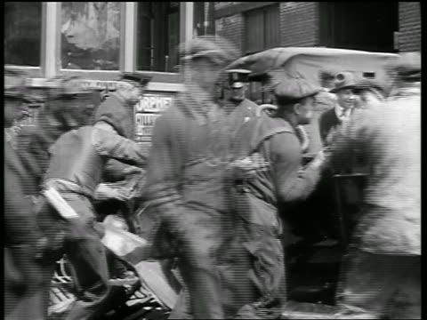 b/w 1919 men pushing car off trolley track on street after being hit by trolley / newsreel - newsreel stock videos and b-roll footage