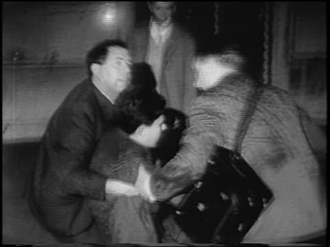 men pushing demonstrator thru door at anti-war rally at night / rome, italy / newsreel - festnahme stock-videos und b-roll-filmmaterial