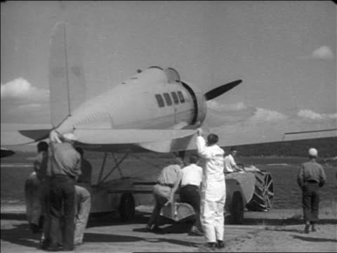 men pushing hydroplane towards water / documentary - 1935 stock videos & royalty-free footage