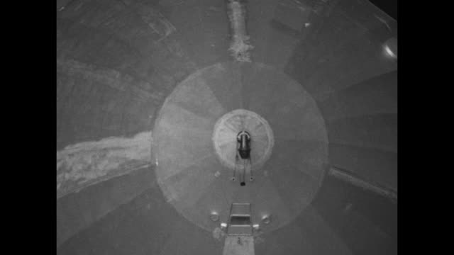 men pushing r33 airship out of hangar men looking out windows of gondola line of men holding mooring line / airship being pushed / various shots... - 1925 stock videos & royalty-free footage