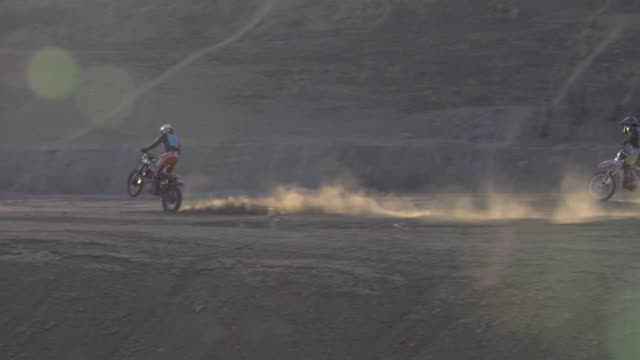 men racing motocross motorcycles on a dirt off road. - off road racing stock videos & royalty-free footage