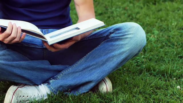 men reading - hardcover book stock videos and b-roll footage