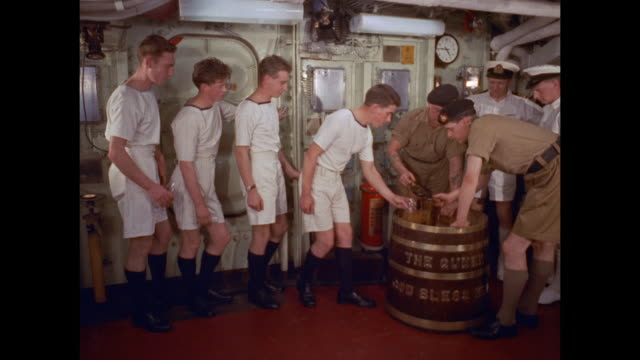 men receive rum ration on aircraft carrier hms victorious - rum stock videos and b-roll footage