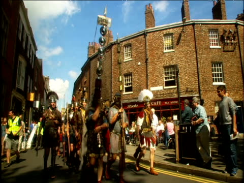 men reenact roman army march york - traditional helmet stock videos and b-roll footage