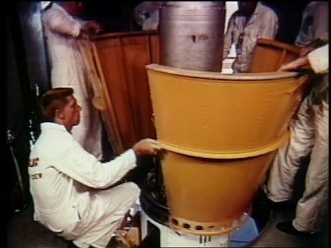 1962 men removing casing around telstar / documentary - telstar stock-videos und b-roll-filmmaterial