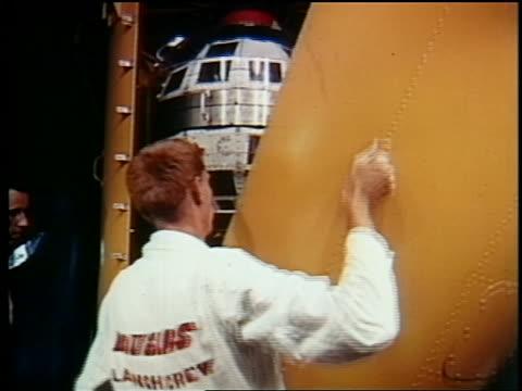 1962 men removing yellow panel to reveal telstar / documentary - telstar stock-videos und b-roll-filmmaterial