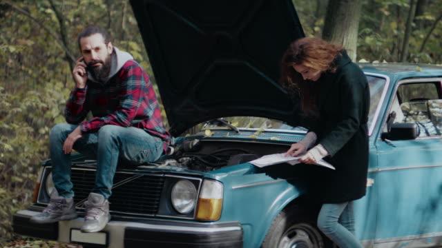 men repairing breakdown car in forest - vintage car stock videos and b-roll footage