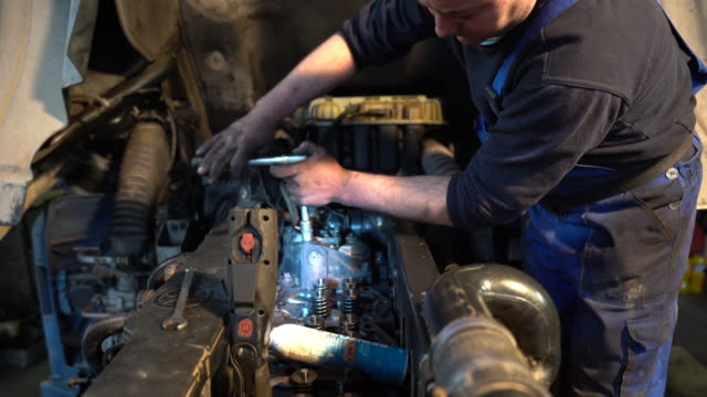 men repairing the engine of the truck - machine part stock videos & royalty-free footage