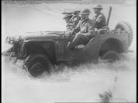 men ride on horseback through georgia cavalry training ground / men on horses pull small car across brook / cross country bantam jeeps drive quickly... - anno 1941 video stock e b–roll