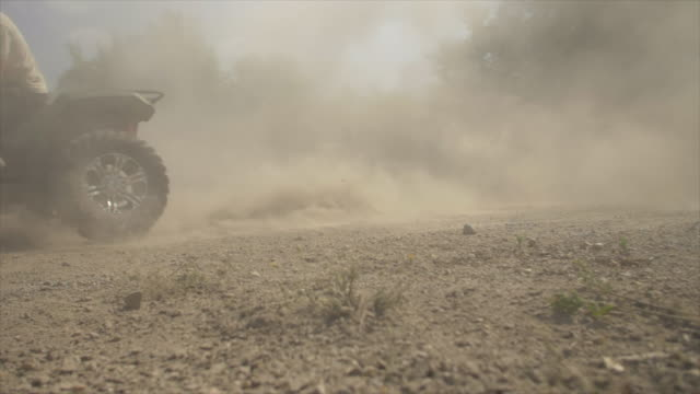 men riding and wheels spinning atv quad motocross motorcycles vehicles on a dirt off road. - wheel stock videos & royalty-free footage