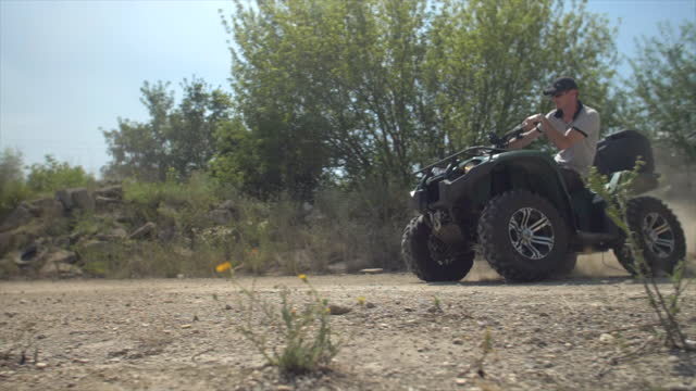 men riding atv quad motocross motorcycles vehicles on a dirt off road. - slow motion - hungary stock videos & royalty-free footage