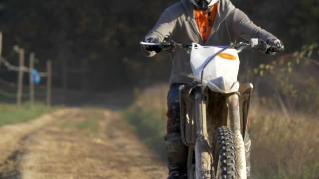 men riding motocross motorcycles on a dirt off road. - slow motion - motocross video stock e b–roll