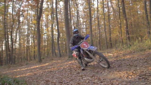 men riding motocross motorcycles on a dirt off road. - motocross video stock e b–roll