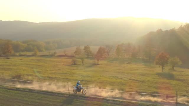 men riding motocross motorcycles on a dirt off road. - スポーツヘルメット点の映像素材/bロール