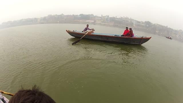 men row boats in the ganges river near the varanasi ghats. - kolkata stock videos & royalty-free footage