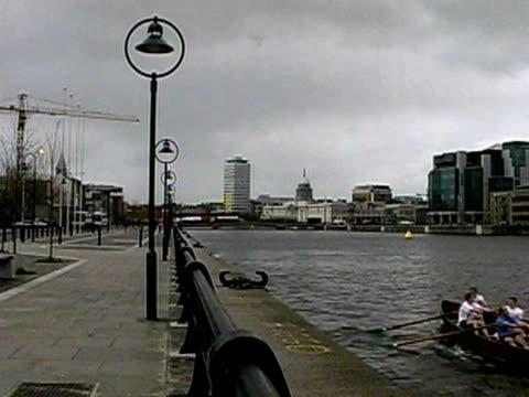 men rowing boat on liffey river, dublin, ireland - 2001 stock videos & royalty-free footage