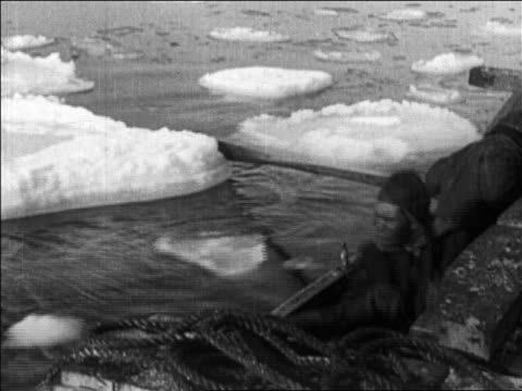 b/w 1926 men rowing rowboat past ice floes / byrd's flight over the north pole / newsreel - only mature men stock videos & royalty-free footage