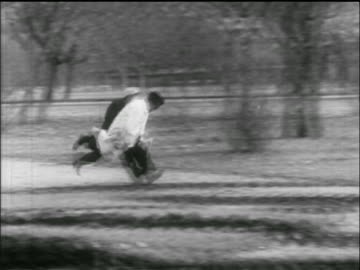men run quickly through park / one trips / hungarian uprising - 1956 stock videos & royalty-free footage