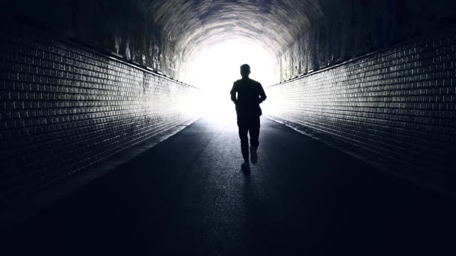 men running forward to freedom - light at the end of the tunnel stock videos & royalty-free footage