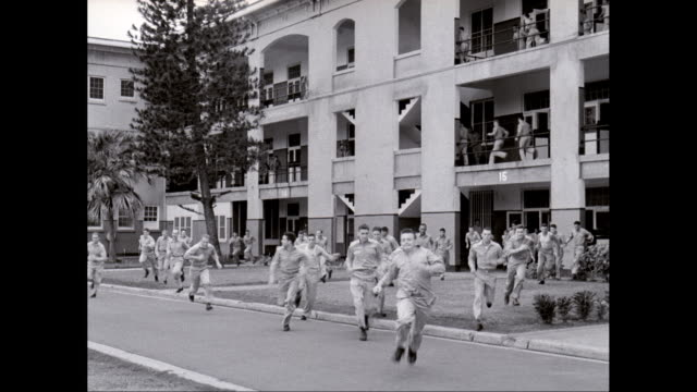 ws men running from military building / hawaii, united states - pearl harbor stock videos and b-roll footage