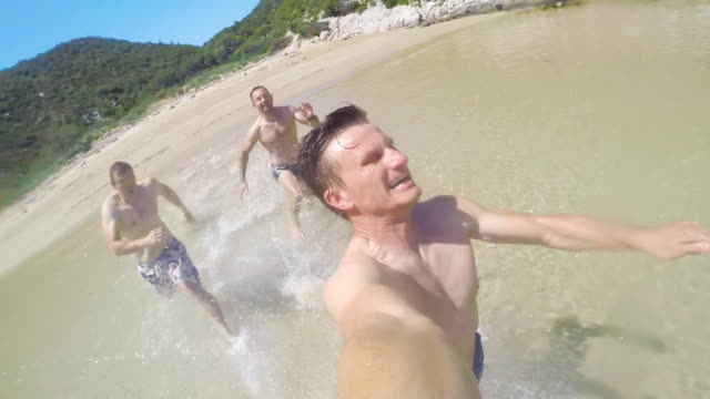 POV Men Running Into The Sea