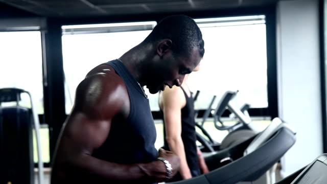 men running on treadmill - treadmill stock videos and b-roll footage