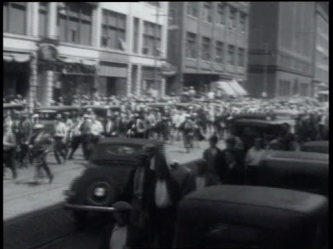 men running / police clubbing men / men running / police holding back men / policeman collecting clubs / policeman pushing crowd of men back - 1934 stock videos & royalty-free footage