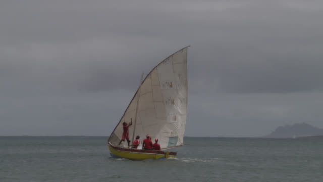 men sail traditional fishing boat, cape verde - verde color stock videos & royalty-free footage