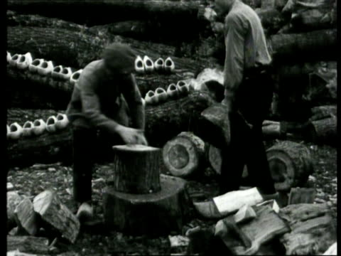 men sawing and cleaving wood to make clogs from, clogs are traded on market, toddler sitting in giant clog / epe, netherlands - 1925 stock videos & royalty-free footage
