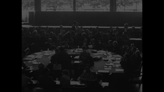 VS men seated at circular conference table Sir Anthony Eden British Foreign Minister at table