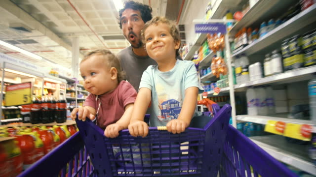 men shopping - family with two children stock videos & royalty-free footage
