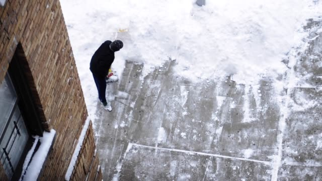 men shoveling sidewalk snow outside a building in the borough of the bronx during february 2013 snow storm, new york city, usa new york snow storm... - 2013 stock videos & royalty-free footage
