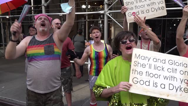 men sing 'god is a dyke' as they perform this song every year at the same street corner during the 29th annual dyke march celebrating lgbtq pride on... - azul stock videos & royalty-free footage