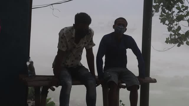 men sit out during a dust storm on may 01, 2021 in guwahati, india. - surface level stock videos & royalty-free footage