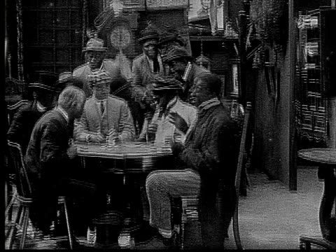1916 b&w ms men sitting at table and playing poker  - 1916 stock videos & royalty-free footage