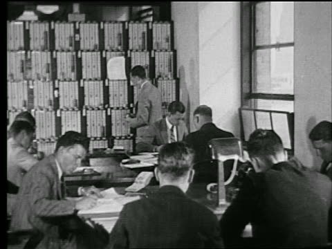 stockvideo's en b-roll-footage met b/w 1927 men sitting at tables in library writing / industrial - 1927